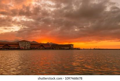 Izmir, Turkey - Circa December 2017 - A beautiful sunset shot of Konak Pier and Konak Pier Mall in Izmir, Turkey with striking orange and red sky
