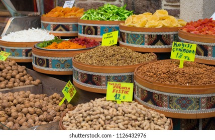 Izmir, Turkey - Circa December 2017 - A shot of colorful dried nuts and fruits on display for sale in one of the markets in Izmir, Turkey