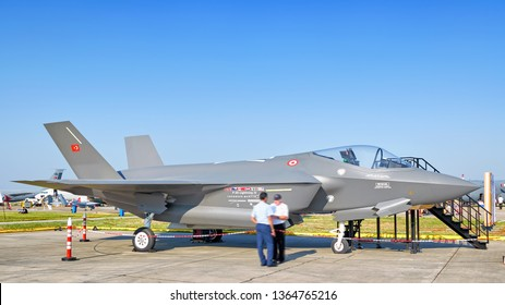 IZMIR, TURKEY - CIRCA MAY, 2011: Turkish air force Lockheed Martin F-35 Lightning II full scale mock up military fighter jet airplane at turkey airport with blue sky landscape background ground view