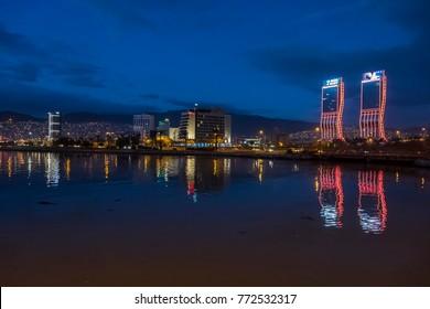 Izmir, Turkey - December 10, 2017 : New skycrapers district of Izmir City night view from sea. Izmir is the third biggest city of Turkey.