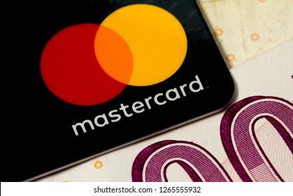 Izmir, Turkey - December 2018: Mastercard credit card logo closeup on Turkish lira banknote background.