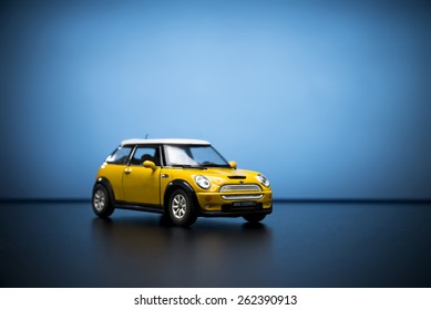 Izmir, Turkey - February 28, 2015.  Mini Cooper S Toy car on blue background.