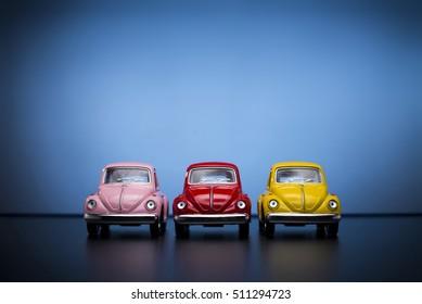 Izmir, Turkey - February 28, 2015. Toy Volkswagen Beetle product shot on blue background.