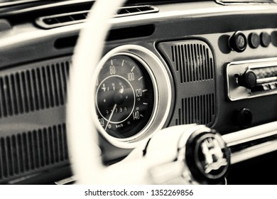 Izmir, Turkey - February 8, 2019: Close up shot Speedometer, dashboard and radio of a Volkswagen beetle with grain effect.