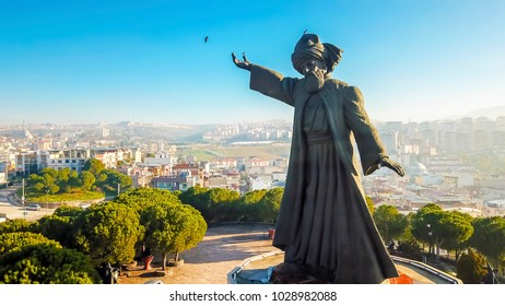 Izmir, Turkey - January 06, 2018 : Mevlana Statue aerial view in Buca District. Mevlana Celaleddin-i Rumi is a sufi philosopher and mystic poet of Islam.
