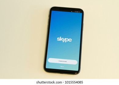 IZMIR ,TURKEY - JANUARY 14, 2018: Smartphone Apple iPhone X 64GB Space Gray Color, Open apps Skype application on the screen on the White clean background.