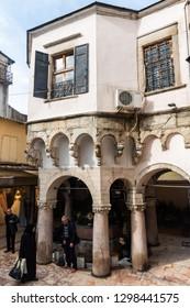 Izmir, Turkey - January 26, 2019. Ablution fountain of Sadirvan mosque in Izmir, with people.