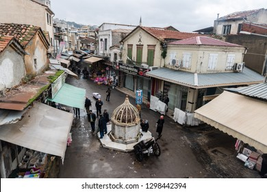 Izmir, Turkey - January 26, 2019. Street view in Kemeralti market in Izmir, with small ablution fountain, shops and people