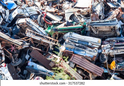 IZMIR, TURKEY - JULY 19, 2012: Wrecked vehicles are seen in a car junkyard near the town of Foca