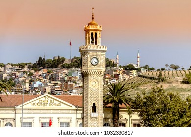 Izmir, Turkey -July, 2014: historical clock tower, it was built in 1901 and accepted as the symbol of Izmir City. Konak Square with walking ordinary people