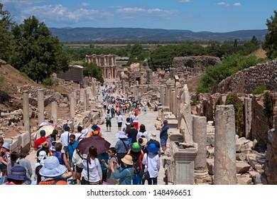 IZMIR, TURKEY - JUNE 3: Unidentified tourists visit greek-roman ruinsof Ephesus on June 3, 2013. Ephesus aims to receive more than 2 millions tourists in 2013.