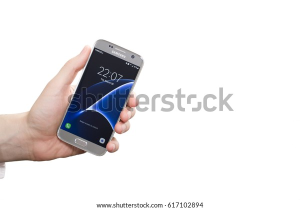 Izmir, Turkey - March 28, 2017: Man checks android application new Samsung Galaxy S 7 in his hand. Samsung S7 was created and developed by Samsung Electronics.