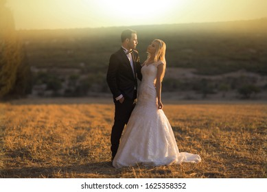 IZMIR, TURKEY - May 06, 2017: Young bride and groom in wedding dress, marriage day outdoor photo shooting.