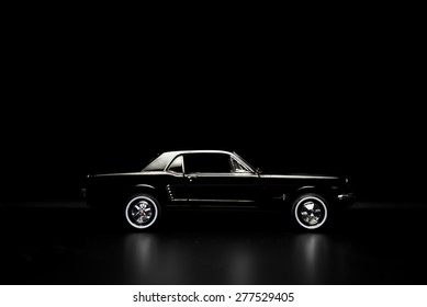 Izmir, Turkey - May 13, 2015.  Ford mustang 260 toy car product shot. Side view on a black background.