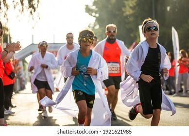 Izmir, Turkey - October 04, 2020. Running people at Finish line Marathon Izmir competition in Izmir Turkey