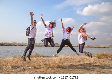 Izmir, Turkey - October 14, 2018: Color Sky 5K is Color Running Festival in Izmir, Turkey. People run during the color throw. After running, people dancing and celebrating with colored face.