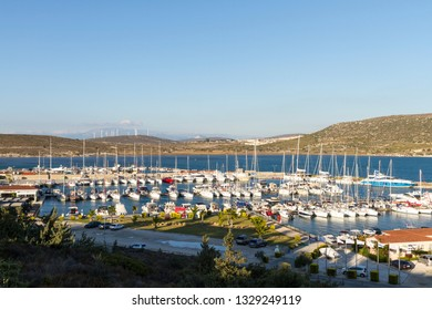 IZMIR ,TURKEY - OCTOBER 26, 2017: Alacati Port is large luxury yacht harbor with shopping mall in Cesme which is a Mediterranean town on the Western coast of Turkey, often noted for its architecture.