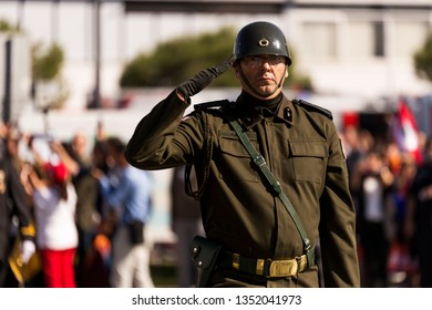 Izmir, Turkey - October 29, 2018: Turkish Colonel with eye glasses Saluting. On Military walking of Republic Day of Turkey.