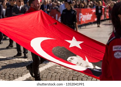 Izmir, Turkey - October 29, 2018: Turkish flag with Mustafa Kemal Ataturk photo on it and a clove is about to fall on to the flag.