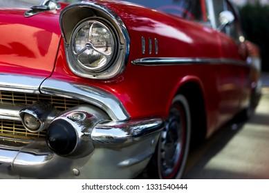 Izmir, Turkey - September 23, 2018: Front side head lights an bumper of a red colored 1957 Chevrolet Izmir Turkey.