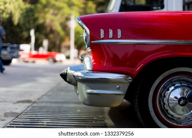 Izmir, Turkey - September 23, 2018: Front side head lights, tire and bumper of a red colored 1957 Chevrolet Izmir Turkey.
