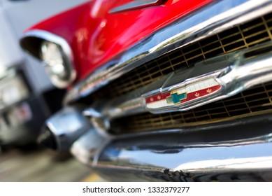 Izmir, Turkey - September 23, 2018: Front side Emblem of a red colored 1957 Chevrolet Izmir Turkey.