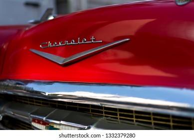 Izmir, Turkey - September 23, 2018: Front side Logo of a red colored 1957 Chevrolet Izmir Turkey.
