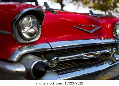 Izmir, Turkey - September 23, 2018: Front side Logo and headlights of a red colored 1957 Chevrolet Izmir Turkey.