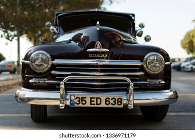 Izmir, Turkey - September 23, 2018: Front view of a Dark Red black colored 1948 Plymouth Deluxe.