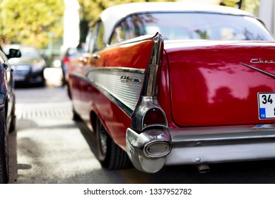 Izmir, Turkey - September 23, 2018: Trunk and Back side logo of a Red 1957 Chevrolet. We see the emblem and the bumper.
