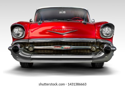 Izmir, Turkey - September 23, 2018: Front view of a red colored 1957 Chevrolet on a white background