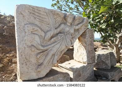 IZMIR, TURKEY - SEPTEMBER 23, 2019: Stone carving of the goddess Nike in Ephesus Ancient City, Selcuk Town, Izmir City, Turkey