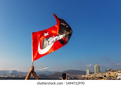 Izmir, Turkey - September 9, 2018. September 9 Independence day of Izmir. Crowded people in the square of Gundogdu and Turkish flags in crowded people.