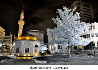 izmir yali cami camii holy mosque konak meydani minaret infrared photo with snowy trees