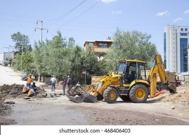 IZMIT, TURKEY - MAY 28, 2009: 2009 British JCB 3CX backhoe loader at work in street of Izmit, Turkey