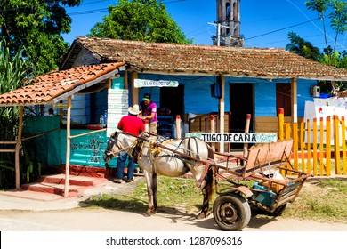 IZNAGA, CUBA - NOVEMBER 27, 2017: Guarapo or sugar cane juice for sell on the side of the road in the kiosk
