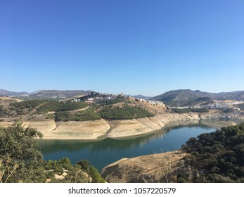 Iznate, Malaga, Andalusia, Spain. September 12th 2017: View of Iznate on the Hill above the reservoir