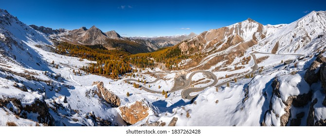 Izoard Pass (Col d'Izoard), the scenic D902 road and Napoleon Refuge in Autumn with snow. Queyras Regional Natural Park, Hautes Alpes (05), Alps, France