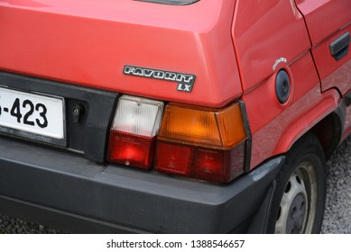IZOLA, SLOVENIA - MARCH 21, 2016: Skoda Favorit LX popular East European 1980s compact car designed by Bertone made in Czechoslovakia pictured on the modern city street. Tail light and emblem.
