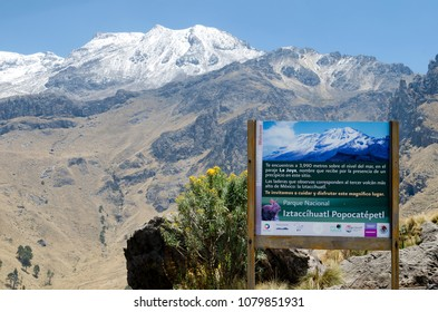Iztaccihuatl Popocatepetl National Park, Mexico, 2018-04-20: sign of national park at the entrance to the hiking routs in mountains with the view to snowy peak of Iztaccihuatl volcano