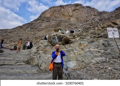 Jabal Nur,Mecca-January 26th, 2018:A muslim man taking photo at the bottom of Jabal Nur. On top of Jabal Nur is the Hira Cave where Prophet Muhammad received his first Quran Verse.
