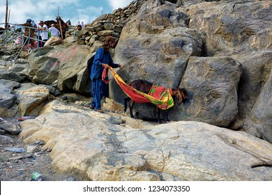 Jabal Nur,Mecca-January 26th,2018:A shepherd guiding his goat down from the top of Jabal Nur.Jabal Nur is where Hira cave is situated.