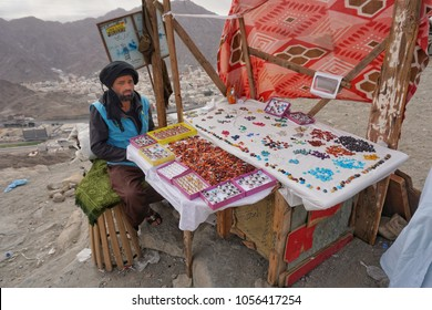 Jabal Nur,Mecca-January 27th,2018:Potrait shot of a salesman with his stall selling lots of colour stones. You can find a lot of people selling items along the way up toward Jabal Nur peak.