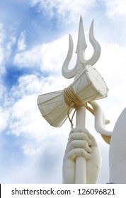 JABALPUR, INDIA - AUGUST 07: Closeup of drum and trident of the 76 feet tall Lord Shiva statue on August 07, 2012 at Kachnar City, Jabalpur, India. This is one of the tallest statues in India