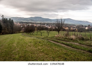 Jablunkov city with hills of Moravskoslezske Beskydy mountains on the background in Czech republic during cloudy autumn day