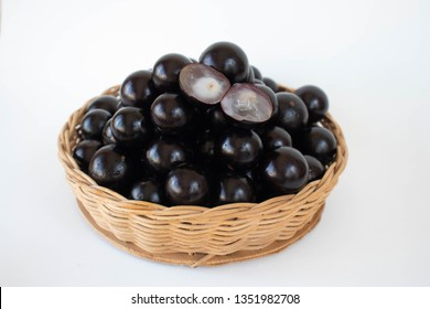 Jaboticaba in a basket on a white background
