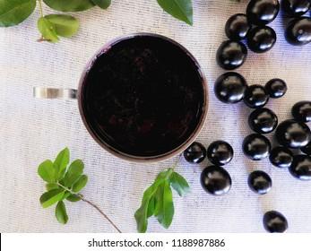 Jabuticaba jelly white towel fruits and leaves