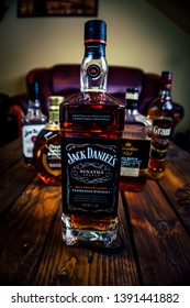 Jack Daniel's Frank Sinatra edition whiskey bottle on wooden pallet table with other whiskey bottles in the background