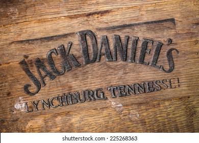Jack Daniels whiskey logo burned at the bottom of old wooden barrel