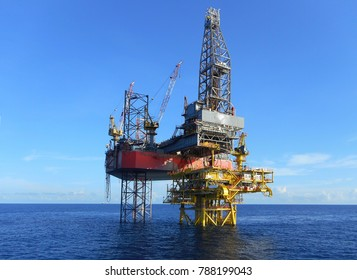 Jack up drilling rig with blue sky background